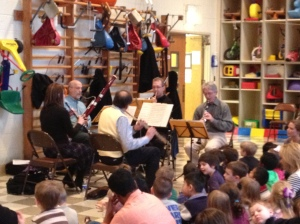 The quintet—Richard Graef, Anne Bach, Dennis Michel, James Smelser, and J. Lawrie Bloom—entertains Stock's kids and teachers