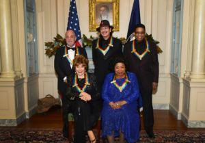 Kennedy Center Honors recipients Billy Joel, Carlos Santana, Herbie Hancock, Shirley MacLaine, and Martina Arroyo in Washington, D.C. on December 8, 2013