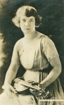 Front of a photo postcard of violinist Amy Neill . . .