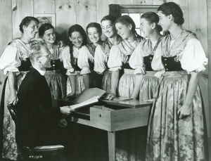 Undated publicity photo of Maria von Trapp and her daughters with Franz Wasner at the keyboard