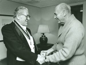 Sir Georg Solti congratulates Jacobs following his retirement ceremony on September 29, 1988
