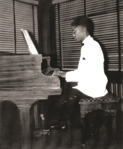 Young Herbie at the piano (image from Hancock's autobiography Possibilities, used with permission)