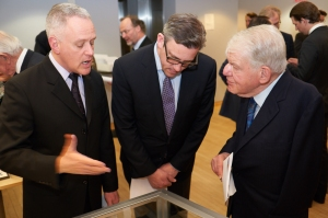 Frank Villella, archivist for the Chicago Symphony Orchestra, describes the Strauss manuscript to Matthew VanBesien, president of the New York Philharmonic, and William Josephson