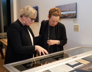 Silvia Kargl, archivist for the Vienna Philharmonic, gives a tour of the artifacts to Jamie Bernstein