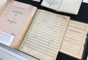 Strauss's manuscript score for his Symphony in F minor, paired with the New York Philharmonic program from the world premiere, December 13, 1884